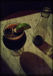 Boozy Cola: Rum, Fernet, Sassafras, served with a cola bottle.